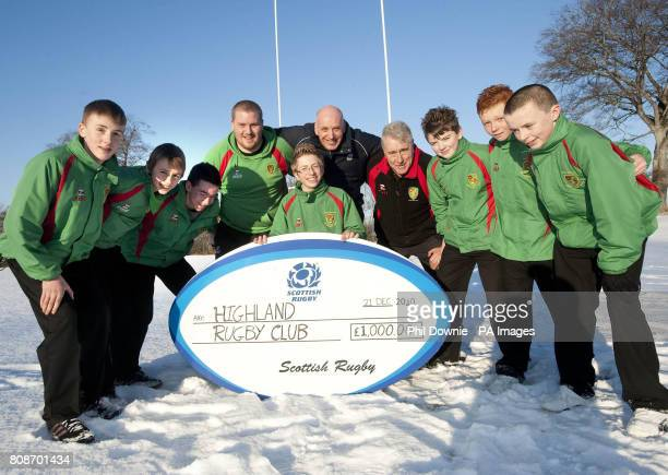 Bruce Flockhart Rory Carson Tom Brogan Iain Crush Ross Dingwall Jack Lingard and Ryan Gallacher with Highland Rugby Club's Alan Falconer with SRU...