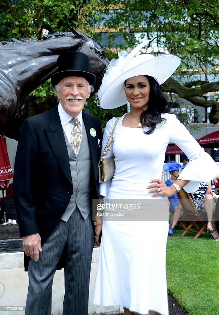 Bruce Forsyth and his wife Wilnelia Merced attend Royal Ascot 2015 at Ascot racecourse on June 16 2015 in Ascot England