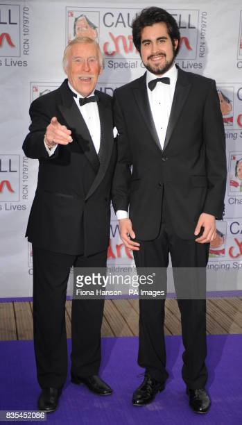 Bruce Forsyth and son Jonathan arrive for the Butterfly Ball in Battersea Park London The event by Caudwell Children aims to raise funds for disabled...