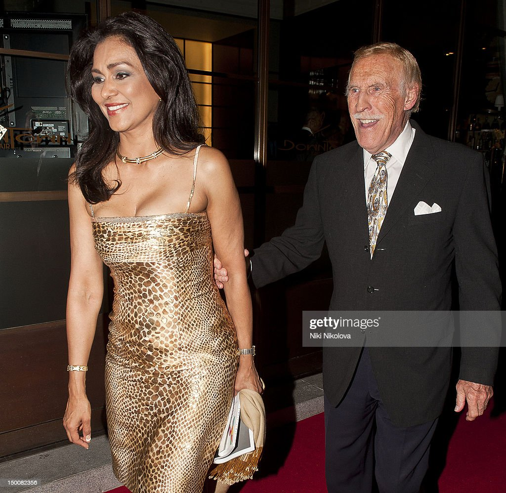 <a gi-track='captionPersonalityLinkClicked' href=/galleries/search?phrase=Bruce+Forsyth&family=editorial&specificpeople=158119 ng-click='$event.stopPropagation()'>Bruce Forsyth</a> and <a gi-track='captionPersonalityLinkClicked' href=/galleries/search?phrase=Wilnelia+Merced&family=editorial&specificpeople=2127377 ng-click='$event.stopPropagation()'>Wilnelia Merced</a> at <a gi-track='captionPersonalityLinkClicked' href=/galleries/search?phrase=Naomi+Campbell&family=editorial&specificpeople=171722 ng-click='$event.stopPropagation()'>Naomi Campbell</a>'s Olympic elebration Dinner on August 9, 2012 in London, England.