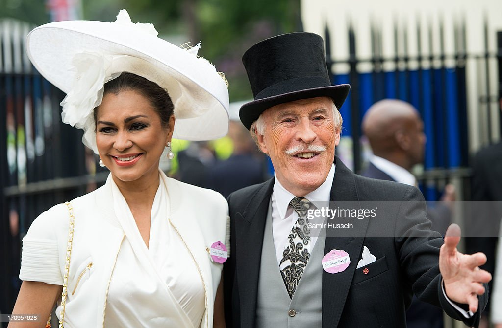 Bruce Forsyth and Wilnelia Merced attend Ladies Day on day 3 of Royal Ascot at Ascot Racecourse on June 20, 2013 in Ascot, England.