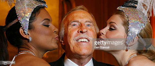 Bruce Forsyth poses at his 80th birthday press conference with Miss Puerto Rico and Miss Great Britain at the Dorchester Hotel in on Februray 22 2008...