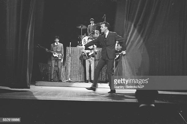 Bruce Forsyth pulls back the curtain as The Beatles appear on 'Sunday Night At The London Palladium' London 13th October 1963
