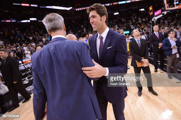 Bruce Fraser and Bob Meyers of the Golden State Warriors talk on the court after winning Game Four of the Western Conference Finals against the San...