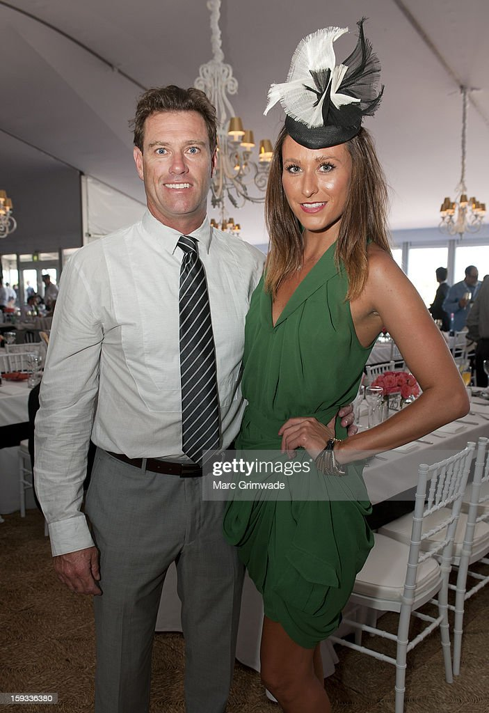 Bruce 'Hoppo' Hopkins and Stacey Woods pose in the Moet & Chandon marquee on Magic Millions Raceday at the Gold Coast Turf Club on January 12, 2013 in Gold Coast, Australia.