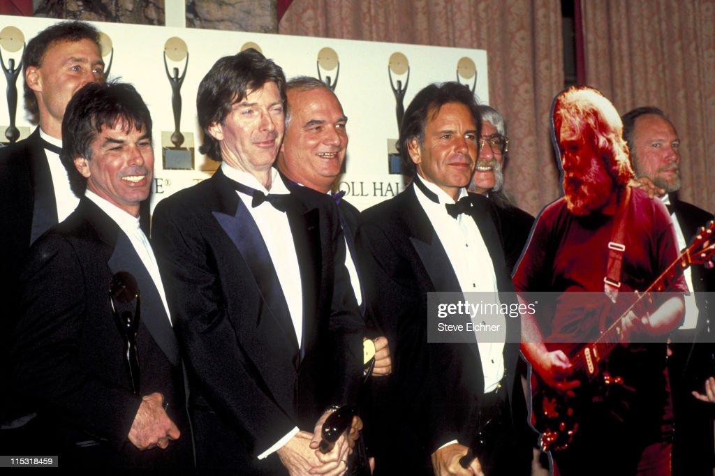 Bruce Hornsby, Mickey Hart, Phil Lesh, Bill Kreutzmann, Bob Weir, Tom Constanten (with cut-out standee of Jerry Garcia) and Vince Welnick of the Grateful Dead