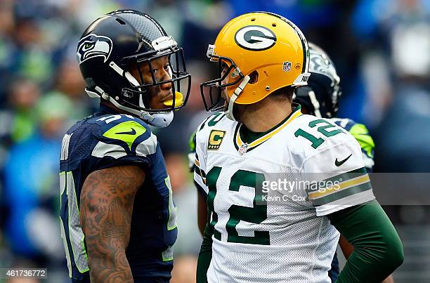 Bruce Irvin of the Seattle Seahawks and Aaron Rodgers of the Green Bay Packers exchange words during the first half of the 2015 NFC Championship game...