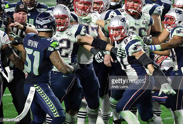 Bruce Irvin of the Seattle Seahawks and Rob Gronkowski of the New England Patriots exchange words late in the fourth quarter during Super Bowl XLIX...