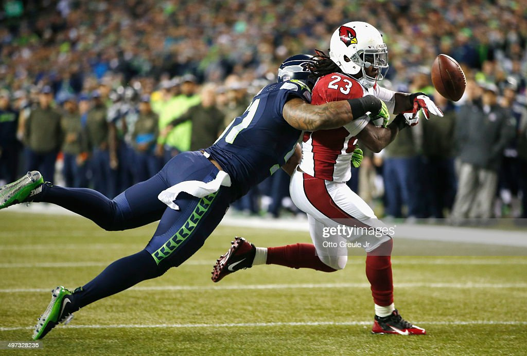Bruce Irvin #51 of the Seattle Seahawks breaks up a pass intended for Chris Johnson #23 of the Arizona Cardinals during the first quarter of a game between the Seattle Seahawks and the Arizona Cardinals at CenturyLink Field on November 15, 2015 in Seattle, Washington.