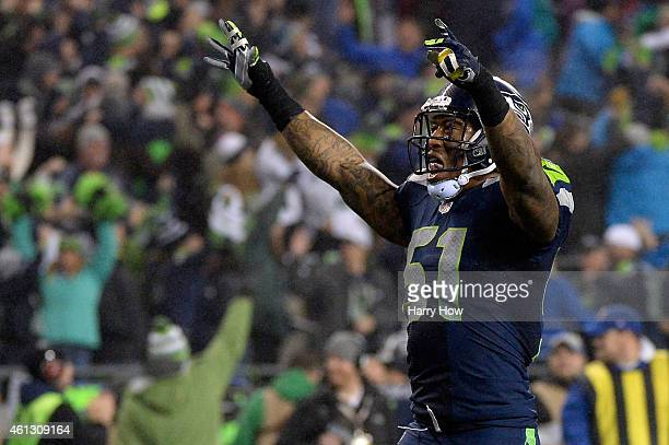 Bruce Irvin of the Seattle Seahawks celebrates Kam Chancellor interception and scoring a 90 yard touchdown in the fourth quarter thrown by Cam Newton...