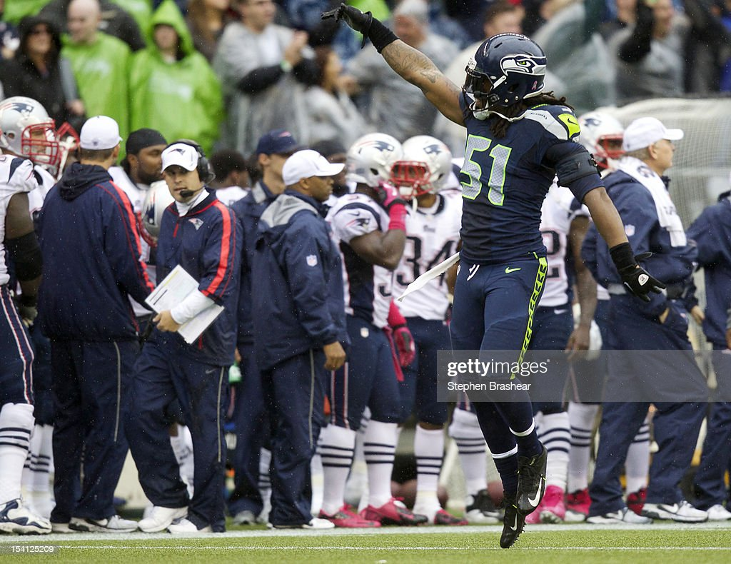 <a gi-track='captionPersonalityLinkClicked' href=/galleries/search?phrase=Bruce+Irvin&family=editorial&specificpeople=7355087 ng-click='$event.stopPropagation()'>Bruce Irvin</a> #51 of the Seattle Seahawks celebrates stopping the New England Patriots late in the fourth quarter of a game at CenturyLink Field on October 14, 2012 in Seattle, Washington. The Seahawks beat the Patriots 24-23.