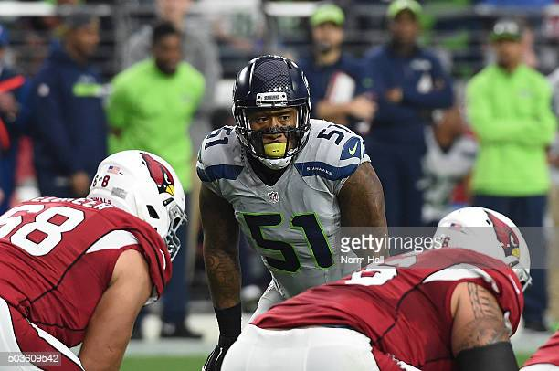 Bruce Irvin of the Seattle Seahawks gets ready to rush the passer against the Arizona Cardinals at University of Phoenix Stadium on January 3 2016 in...