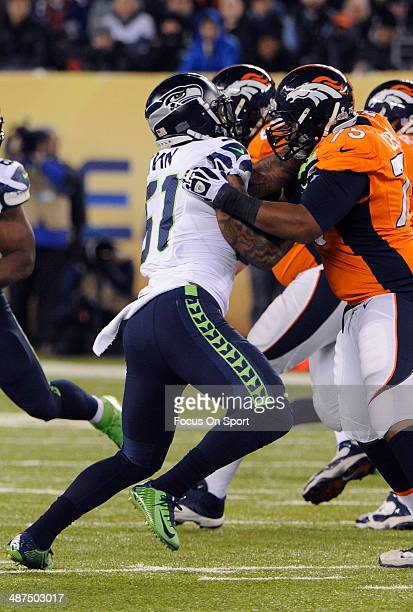 Bruce Irvin of the Seattle Seahawks rushes up against Chris Clark of the Denver Broncos during Super Bowl XLVIII on February 2 2014 at MetLife...