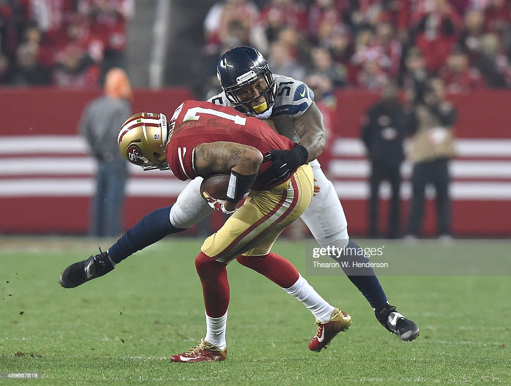 Bruce Irvin #51 of the Seattle Seahawks sacks Colin Kaepernick #7 of the San Francisco 49ers in the third quarter at Levi's Stadium on November 27, 2014 in Santa Clara, California.