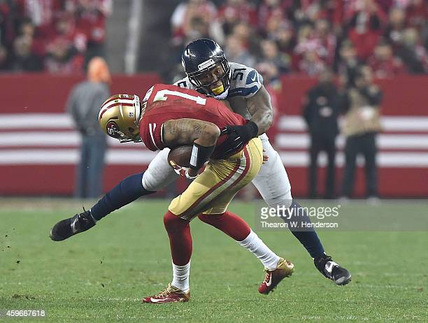 Bruce Irvin of the Seattle Seahawks sacks Colin Kaepernick of the San Francisco 49ers in the third quarter at Levi's Stadium on November 27 2014 in...