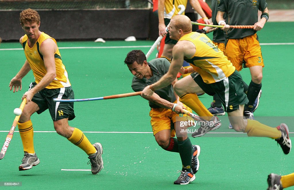 Bruce Jacobs of Australia clashes with Robert Hammond of South Africa while Eric RoseInnes looks on during a match between Australia and South Africa...