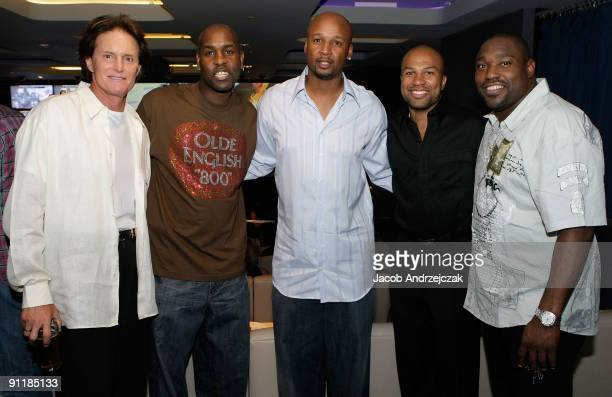 Bruce Jenner basketball player Craig Smith basketball player Gary Payton basketball player Derek Fisher and football player Warren Sapp pose at...