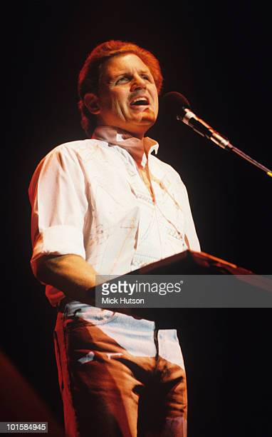 Bruce Johnston of the Beach Boys performs on stage in 1991