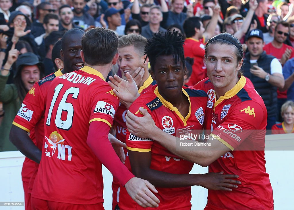 Bruce Kamau of Adelaide United celebrates with team mates after scoring a goal during the 2015/16 A-League Grand Final match between Adelaide United and the Western Sydney Wanderers at Adelaide Oval on May 1, 2016 in Adelaide, Australia.
