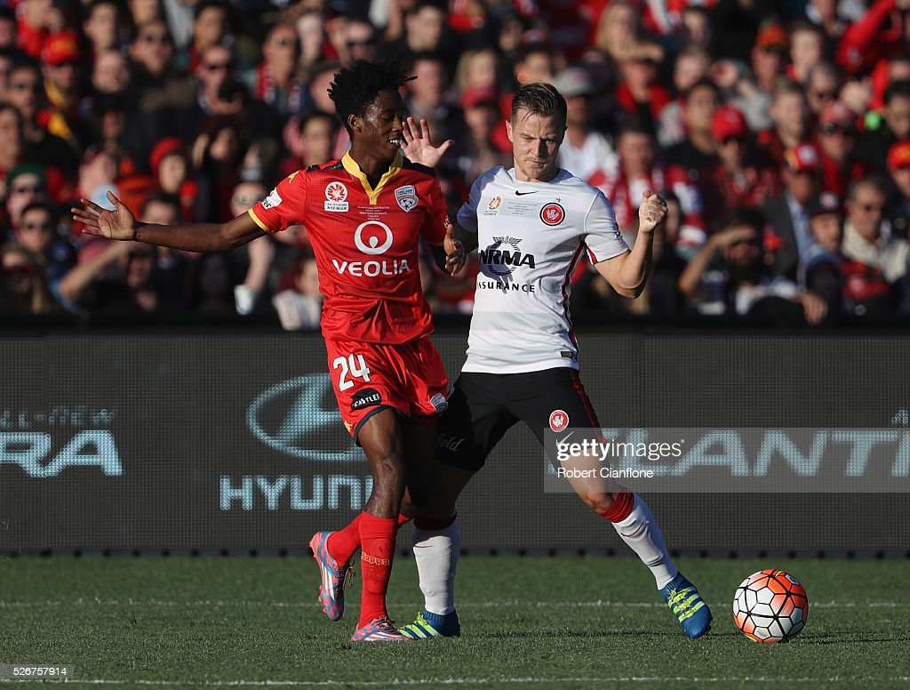 Bruce Kamau of Adelaide United challenges Scott Jamieson of the Wanderers during the 2015/16 A-League Grand Final match between Adelaide United and the Western Sydney Wanderers at Adelaide Oval on May 1, 2016 in Adelaide, Australia.