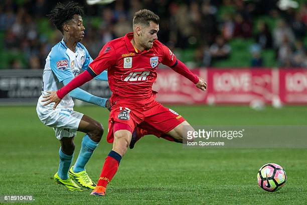 Bruce Kamau of Melbourne City and Ben Garuccio of Adelaide United contest the ball during the 4th round of the Hyundai ALeague between Melbourne City...