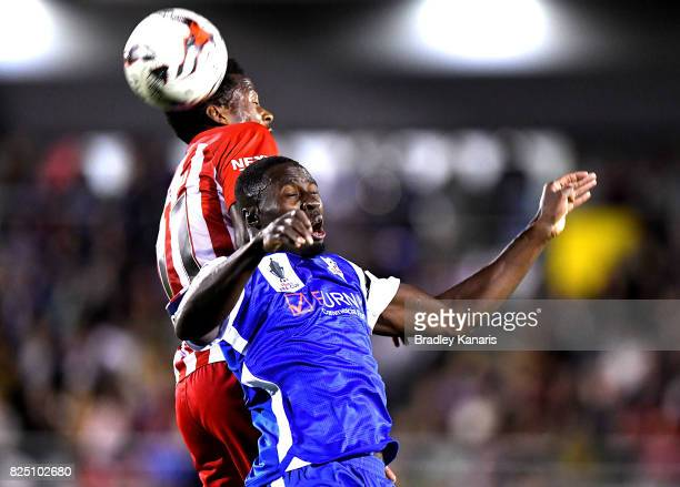 Bruce Kamau of Melbourne City and Charles Mendy of the Power compete for the ball during the FFA Cup round of 32 match between the Peninsula Power...