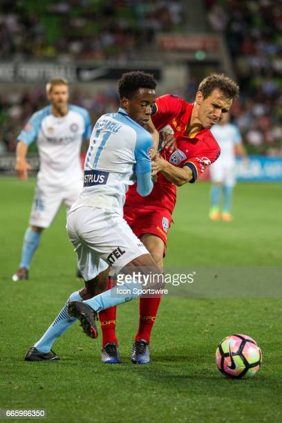 Bruce Kamau of Melbourne City and Isaias of Adelaide United contest the ball during the round 26 match of the Hyundai ALeague between Adelaide United...