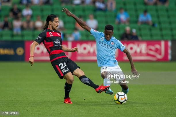 Bruce Kamau of Melbourne City and Raul Llorente of the Western Sydney Wanderers contest the ball during Round 6 of the Hyundai ALeague Series between...
