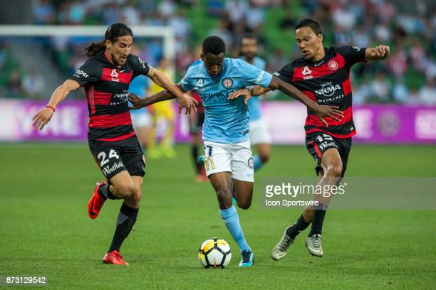 Bruce Kamau of Melbourne City contests the ball with Raul Llorente of the Western Sydney Wanderers and Kearyn Baccus of the Western Sydney Wanderers...