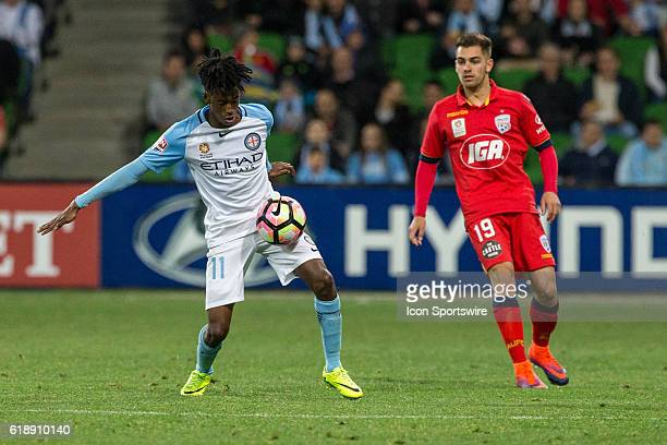 Bruce Kamau of Melbourne City controls the ball in front of Ben Garuccio of Adelaide United during the 4th round of the Hyundai ALeague between...