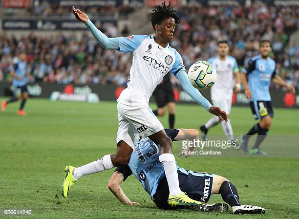 Bruce Kamau of Melbourne City is challenged by Brandon O'Neill of Sydney FC during the FFA Cup Final match between Melbourne City FC and Sydney FC at...