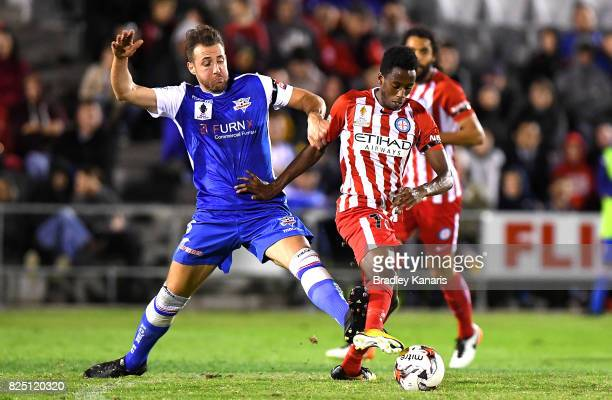 Bruce Kamau of Melbourne City is pressured by the defence of David Salin of the Power during the FFA Cup round of 32 match between the Peninsula...