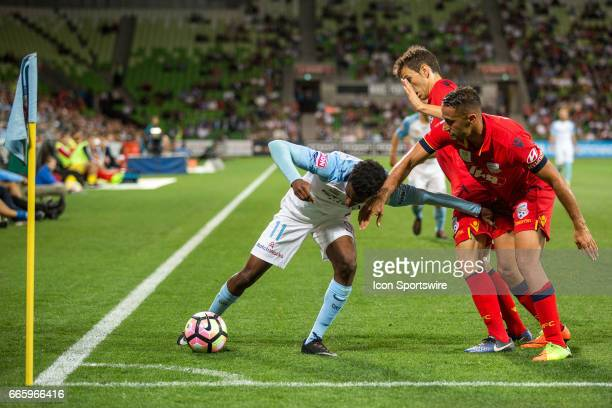 Bruce Kamau of Melbourne City Tarek Elrich of Adelaide United and Isaias of Adelaide United contest the ball during the round 26 match of the Hyundai...
