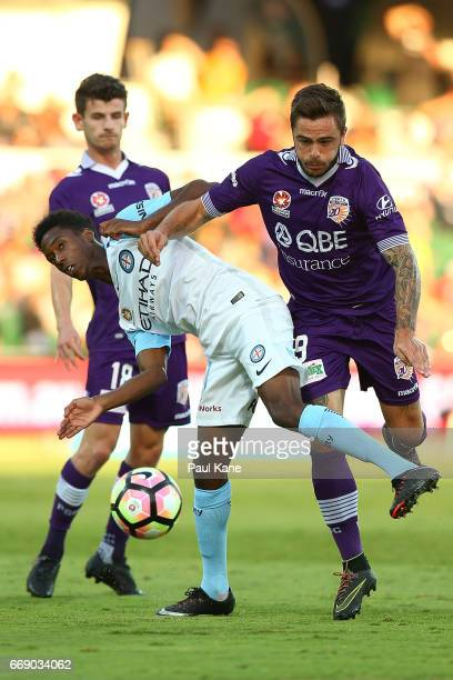 Bruce Kamau of Melbourne contests for the ball against Mitchell Oxborrow and Josh Risdon of the Glory during the round 27 ALeague match between the...