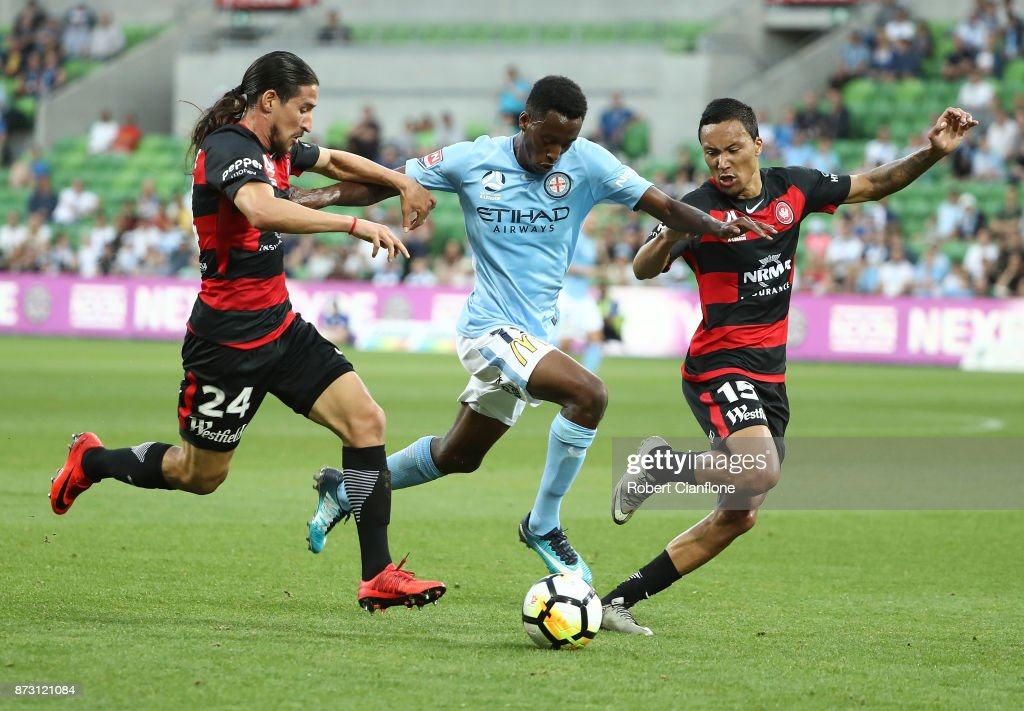 Bruce Kamau of the City is challenged by Raul Llorente and Kearyn Baccus of the Wanderers during the round six A-League match between Melbourne City and the Western Sydney Wanderers at AAMI Park on November 12, 2017 in Melbourne, Australia.