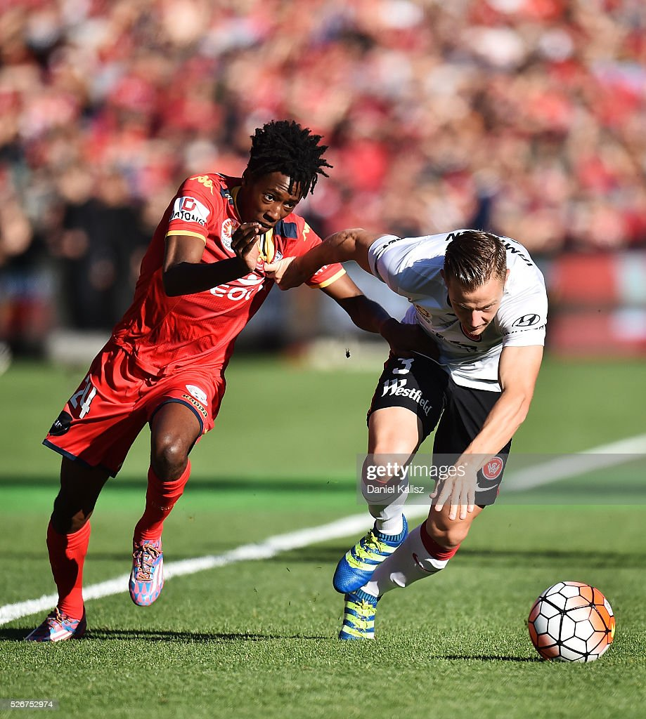Bruce Kamau of United and Scott Jamieson of the Wanderers compete for the ball during the 2015/16 A-League Grand Final match between Adelaide United and the Western Sydney Wanderers at Adelaide Oval on May 1, 2016 in Adelaide, Australia.