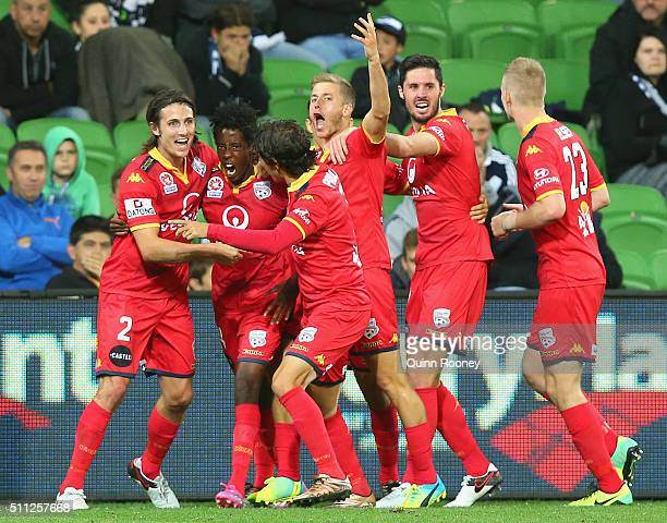 Bruce Kamau of United is congratulated by team mates after scoring a goal during the round 20 ALeague match between Melbourne Victory and Adelaide...