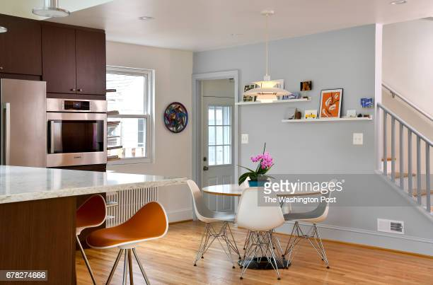 Bruce Marshall and Amy Dibner's new kitchen has sight lines to a dining area and the sitting room April 19 2017 in Silver Spring MD They enlarged the...