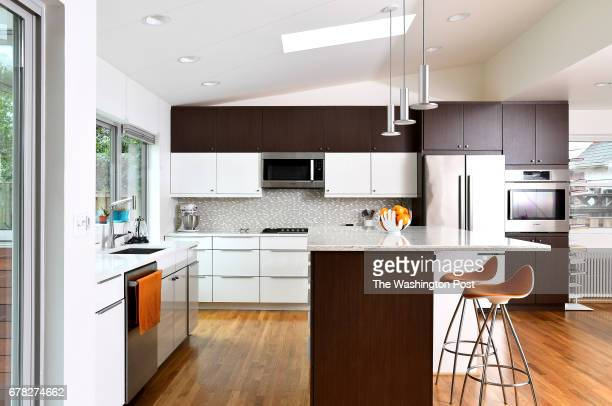 Bruce Marshall and Amy Dibner's new kitchen seen April 19 2017 in Silver Spring MD They enlarged the footprint of their Cape Cod style home with an...