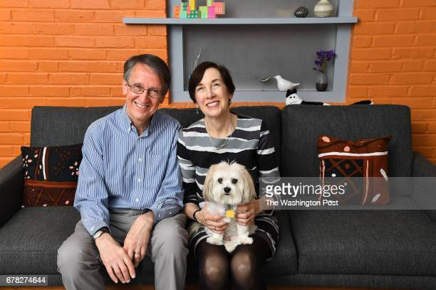 Bruce Marshall and Amy Dibner's pose in the sitting room with Lillie April 19 2017 in Silver Spring MD They enlarged the footprint of their Cape Cod...