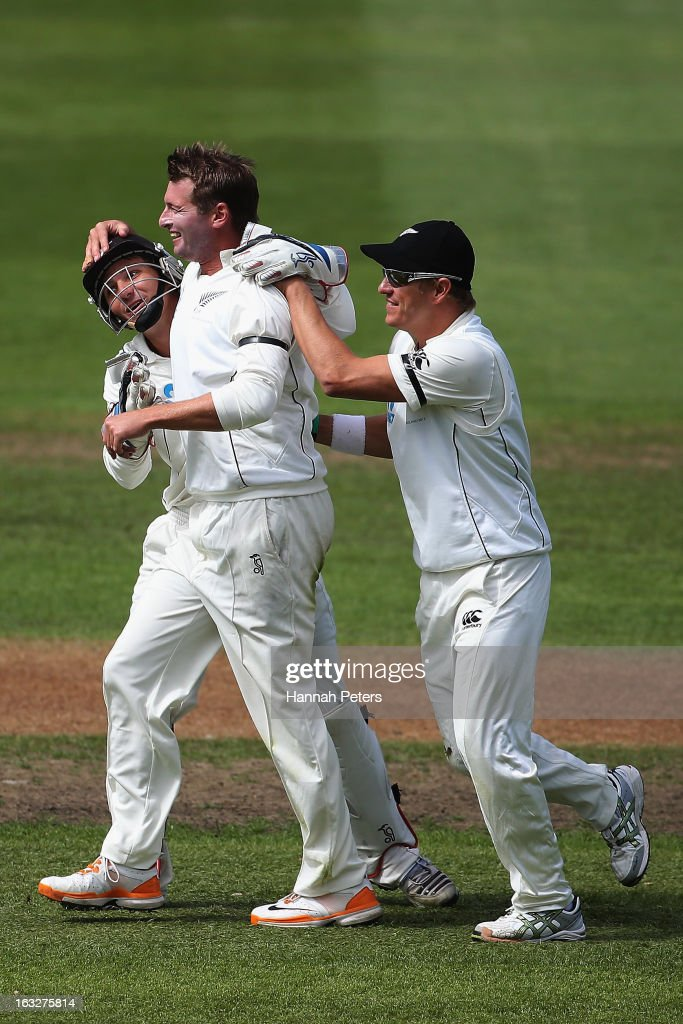 Bruce Martin celebrates his first test wicket of Matt Prior of England with BJ Watling and Neil Wagner of New Zealand during day two of the First Test match between New Zealand and England at University Oval on March 7, 2013 in Dunedin, New Zealand.