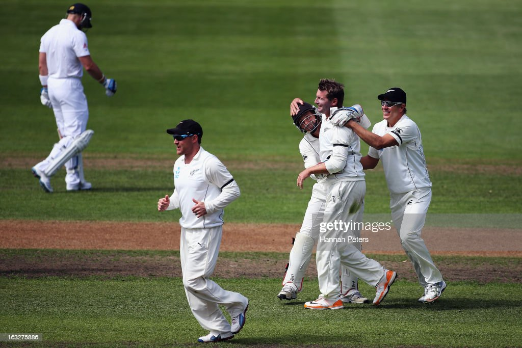 Bruce Martin celebrates his first test wicket of Matt Prior of England with BJ Watling and Neil Wagner of New Zealand during day two of the First...