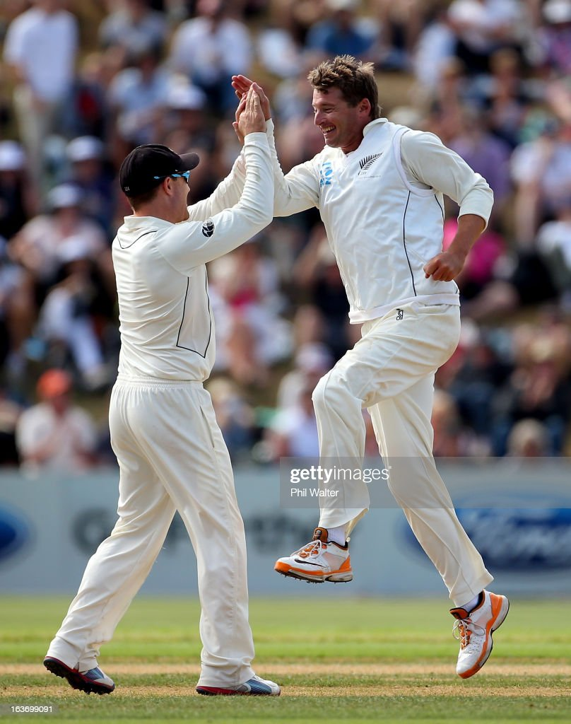 ZEALAND - MARCH <a gi-track='captionPersonalityLinkClicked' href=/galleries/search?phrase=Bruce+Martin&family=editorial&specificpeople=226565 ng-click='$event.stopPropagation()'>Bruce Martin</a> of New Zealand (R) celebrates his wicket of Joe Root of England with <a gi-track='captionPersonalityLinkClicked' href=/galleries/search?phrase=Brendon+McCullum&family=editorial&specificpeople=208154 ng-click='$event.stopPropagation()'>Brendon McCullum</a> (L) during day two of the second Test match between New Zealand and England at Basin Reserve on March 15, 2013 in Wellington, New Zealand.