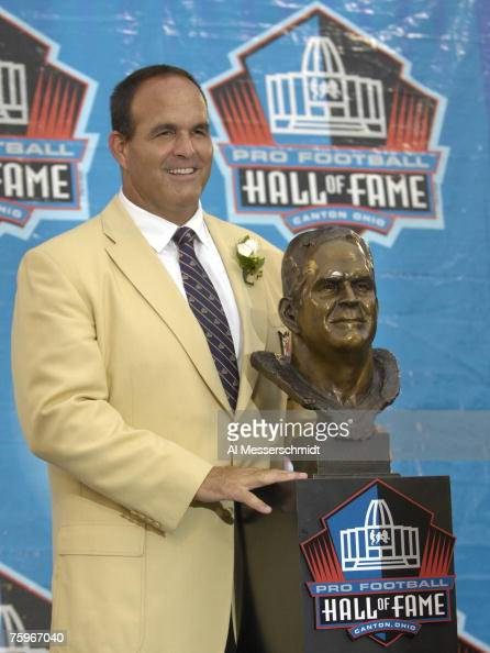 Bruce Matthews poses with his bust during the Class of 2007 Pro Football Hall of Fame Enshrinement Ceremony August 4 2007 in Canton Ohio
