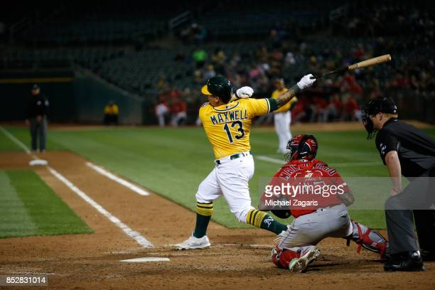 Bruce Maxwell of the Oakland Athletics bats during the game against the Los Angeles Angels of Anaheim at the Oakland Alameda Coliseum on September 5...