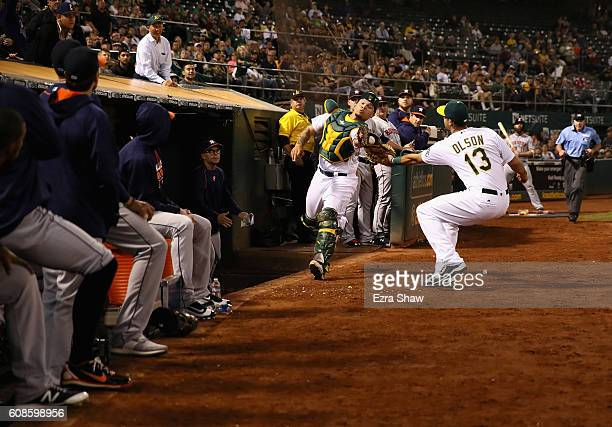 Bruce Maxwell of the Oakland Athletics catches a foul ball hit by Carlos Correa of the Houston Astros in the seventh inning at OaklandAlameda County...