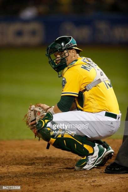 Bruce Maxwell of the Oakland Athletics catches during the game against the Kansas City Royals at the Oakland Alameda Coliseum on August 15 2017 in...