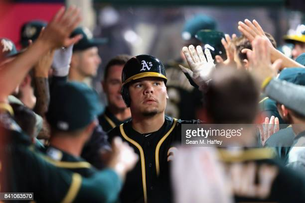 Bruce Maxwell of the Oakland Athletics is congratulated in the dugout after hitting a tworun homerun during the seventh inning of a game against the...