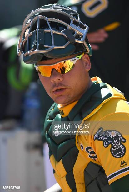 Bruce Maxwell of the Oakland Athletics looks on from the dugout prior to the start of the game against the Seattle Mariners at Oakland Alameda...