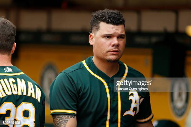 Bruce Maxwell of the Oakland Athletics looks on from the dugout during the fourth inning against the Seattle Mariners at Oakland Alameda Coliseum on...